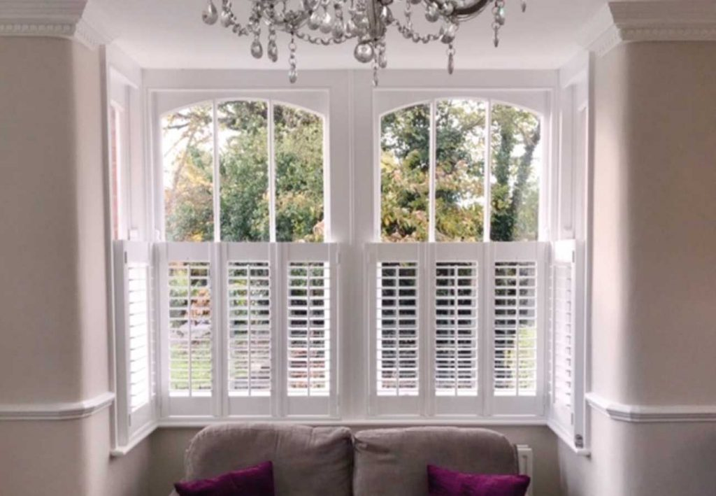 Wooden shutters fitted half way up window frame
