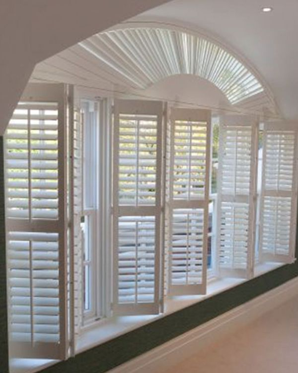 Arched wooden shutters open and foldable