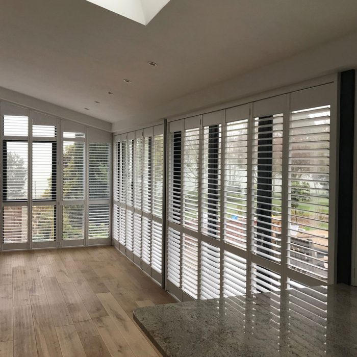 Wooden shutters fitted on an angle in home extension