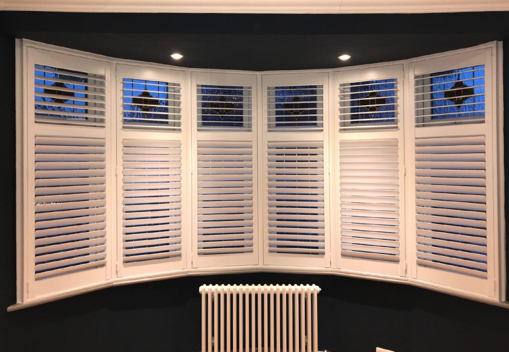 6 panels of white plantation shutters at night time