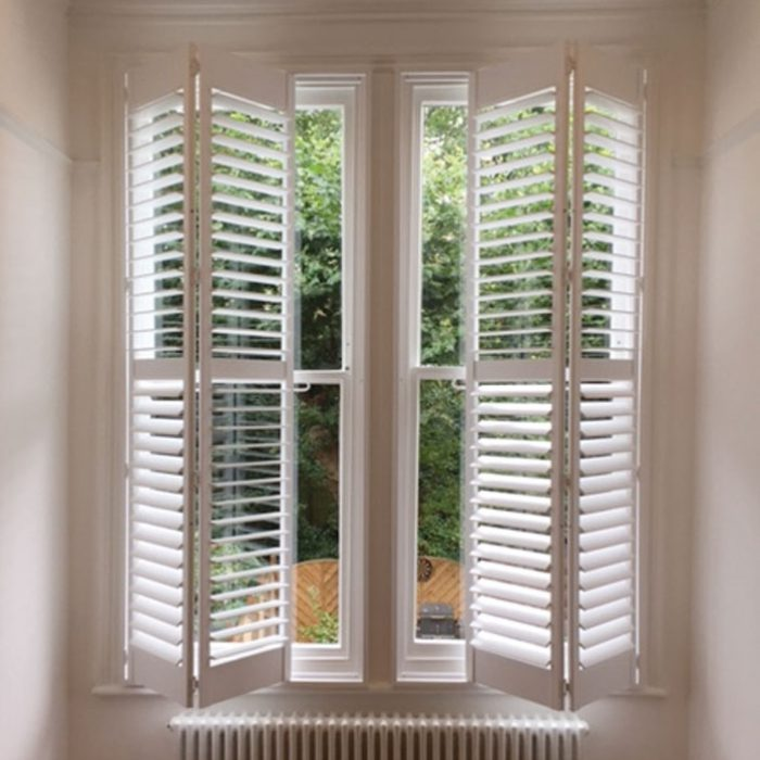 Plantation shutters half open and half folded
