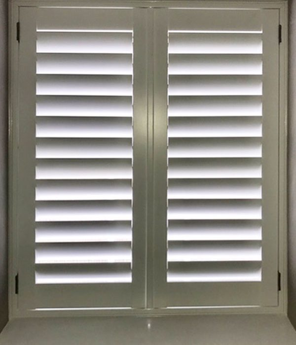 Closed white wooden shutters