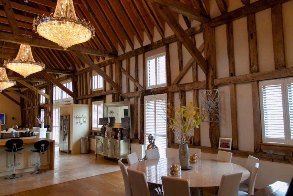 Chandeliers hanging in old barn style home