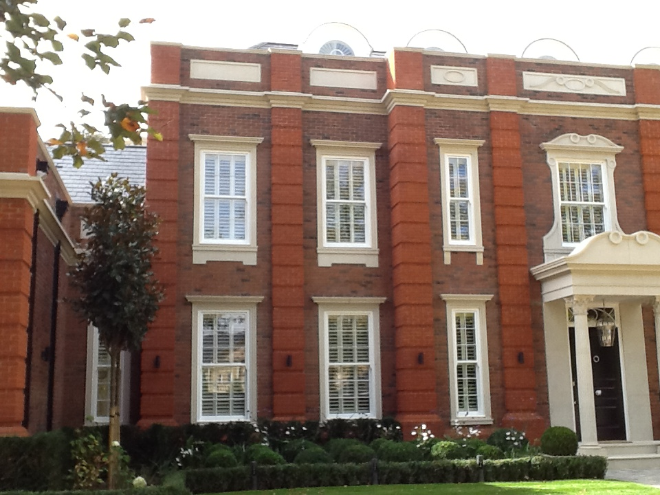 Large red brick house with front garden