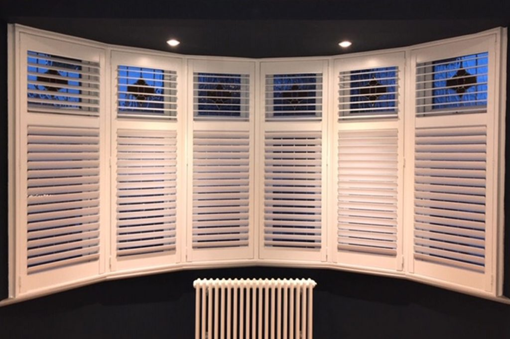 Bay window area at night time with wooden shutters