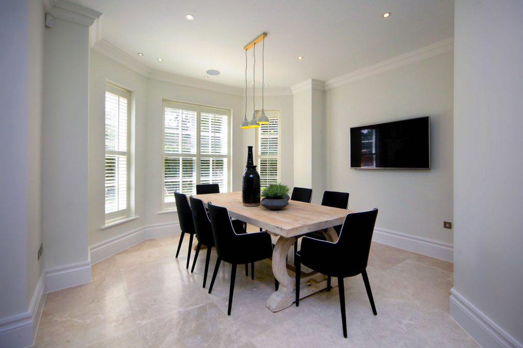 Modern dinning room with bay window wooden shutters