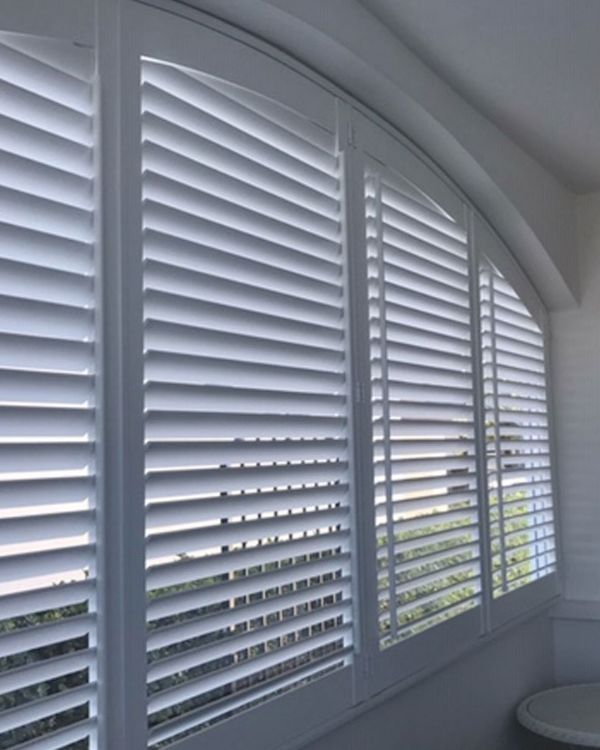 Arched plantation shutters in 4 panels