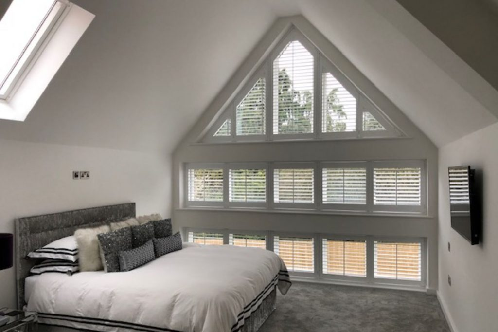 Triangular window frame with plantation shutters fitted