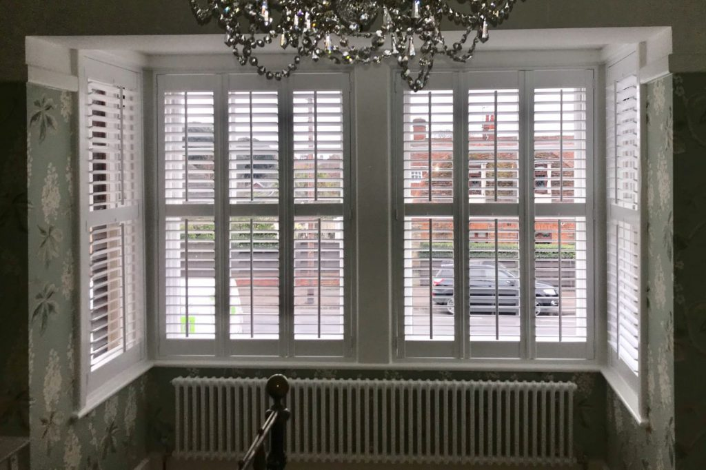 Bay window area with white plantation shutters