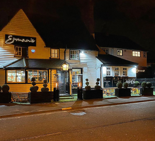 View of pub lit up at night