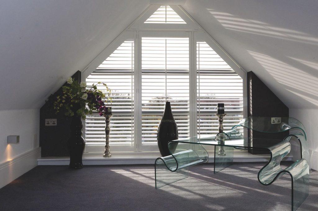 White plantation shutters in modern loft space