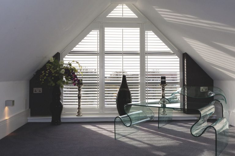 White plantation shutters in modern loft space