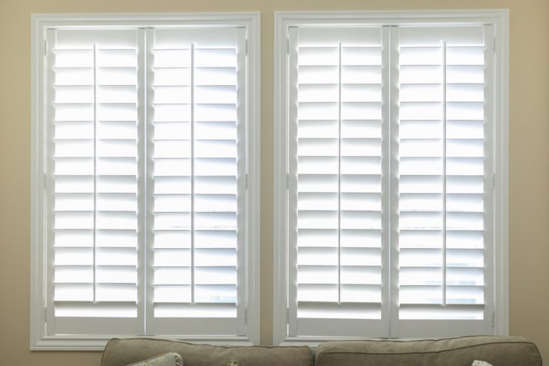 Isolated white wooden shutters