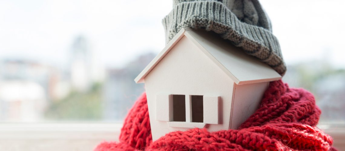 House,In,Winter,-,Heating,System,Concept,And,Cold,Snowy