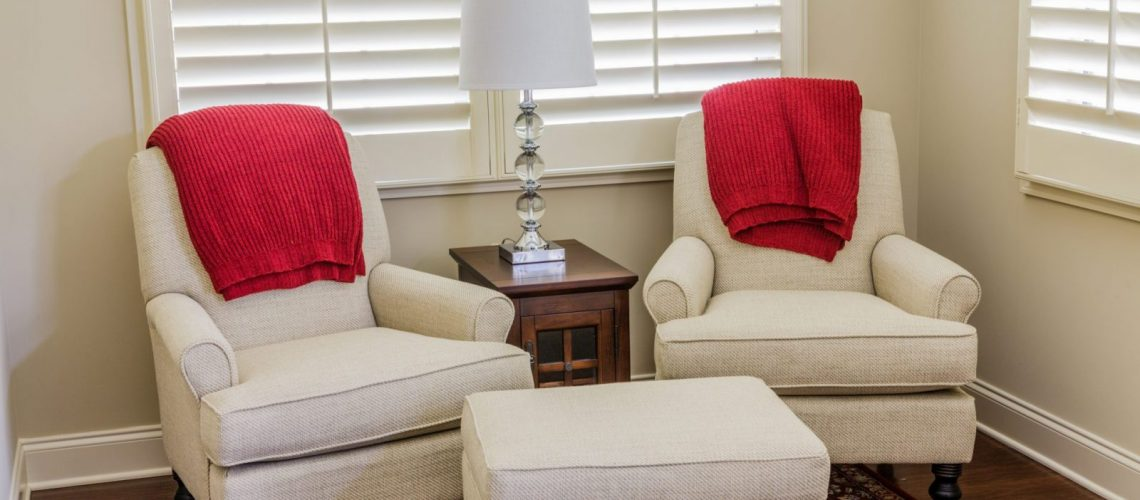 white chairs red cusions blinds